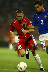 BELGRADE, SERBIA & MONTENEGRO - Wednesday, August 20, 2003: Wales' Craig Bellamy and Serbia & Montenegro's Ivica Dragutinovic during the UEFA European Championship qualifying match at the Red Star Stadium. (Pic by David Rawcliffe/Propaganda)