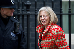 © London News Pictures. 19/03/2013. London, UK.  British Home Secretary Theresa May MP arriving on Downing Street in London for cabinet meeting. Photo credit: Ben Cawthra/LNP.