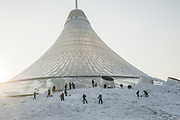 Workers remove snow from the base of the Khan Shatyr shopping centre in Astana, Kazakhstan. The Khan Shatyr is a Norman Foster designed mall in shape of a traditional nomadic tent, built to withstand winter temperatures of -40 degrees.