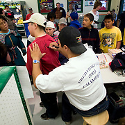 Jordin Tootoo grew up in a small village along the Hudson Bay only a hundred miles from the Arctic Circle. The first Inuit to play professionally in the National Hockey League, Tootoo is close to his family and friends to nearly everyone in Rankins Inlet in Northeast Canada, as is evident at a memorabilia signing at the local market.