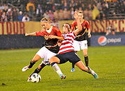 """U.S. Women's National Team striker Abby Wambach (14) fights for the ball against Midfielder Lena Goebling (20) from Germany during the """"Fan Tribute Tour"""" game held in Rentschler Field in East Hartford, CT. on Tuesday, October 23, 2012. The U.S. tied with Germany 2-2."""