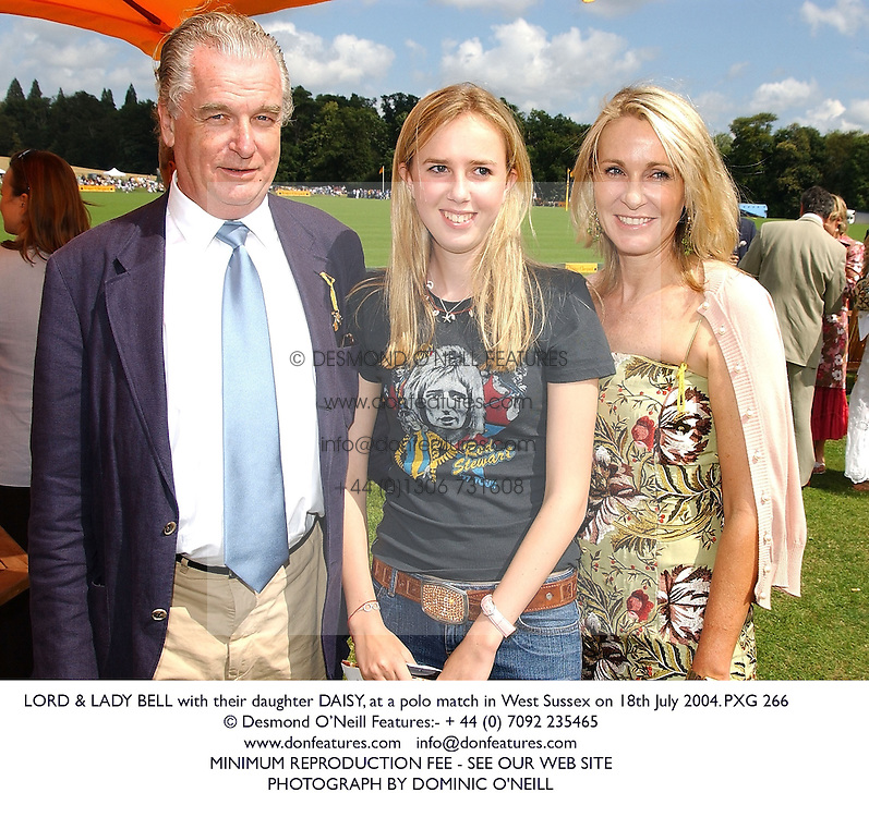 LLORD & LADY BELL with their daughter DAISY, at a polo match in West Sussex on 18th July 2004.PXG 266