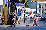 AFRICA; MOROCCO; TANGIER:  Typical street scene in old Tangier with people in traditional dress.