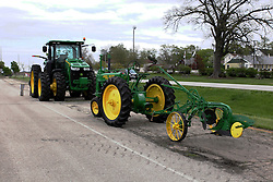 04 May 2013:   Arranged to coincide and be a part of the Red Corridor Route 66 festival, the village of Lexington hosts an antique tractor show.  Roger Whaley is the chairman of the organizing committee.  The new - 8310R John Deere and the old - 1937 John Deere (A), share some asphalt.