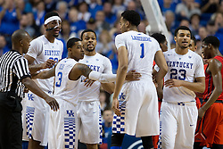 Kentucky guard Tyler Ulis, center, gathers his teammates during a foul situation in the first half. The University of Kentucky hosted Ole Miss, Saturday, Jan. 02, 2016 at Rupp Arena in Lexington.