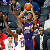 31 October 2016: Phoenix Suns forward T.J. Warren (12) takes a jump shot over Los Angeles Clippers forward Luc Richard Mbah a Moute (12) during the Los Angeles Clippers 116-98 victory over the Phoenix Suns, at the Staples Center, Los Angeles, California, USA.