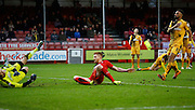 Matt Harrold of Crawley Town manages to steer Lee Barnard of Crawley Town's shot in to the goal to put Crawley Town ahead during the Sky Bet League 2 match between Crawley Town and Cambridge United at the Checkatrade.com Stadium, Crawley, England on 9 January 2016. Photo by Andy Walter.
