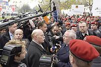 17 NOV 2003, BOCHUM/GERMANY:<br /> Peter Struck (Mi-L), SPD, Bundesverteidigungsminister, und Manfred Gertz (Mi-R), Vorsitzender Deutscher Bundeswehrverband, im Gespraech, waehrend einer Demonstration der Gewerkschaft der Polizei und des Deutschen Bundeswehrverbandes gegen Kuerzungen im oeffentlichen Dienst und bei der Bundeswehr, vor den Toren des SPD Bundesparteitages, Ruhr-Congress-Zentrum<br /> IMAGE: 20031117-01-017<br /> KEYWORDS: Parteitag, party congress, SPD-Bundesparteitag, Demo, Gespräch, Mikrofon, microphone
