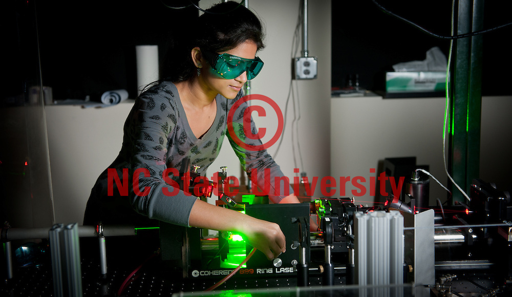 A student works in the Jet Laser Lab. Photo by Marc Hall