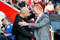Southampton manager Ronald Koeman greets Vitesse Arnhem manager Peter Bosz - Mandatory by-line: Jason Brown/JMP - Mobile 07966386802 - 31/07/2015 - SPORT - FOOTBALL - Southampton, St Mary's Stadium - Southampton v Vitesse Arnhem - Europa League