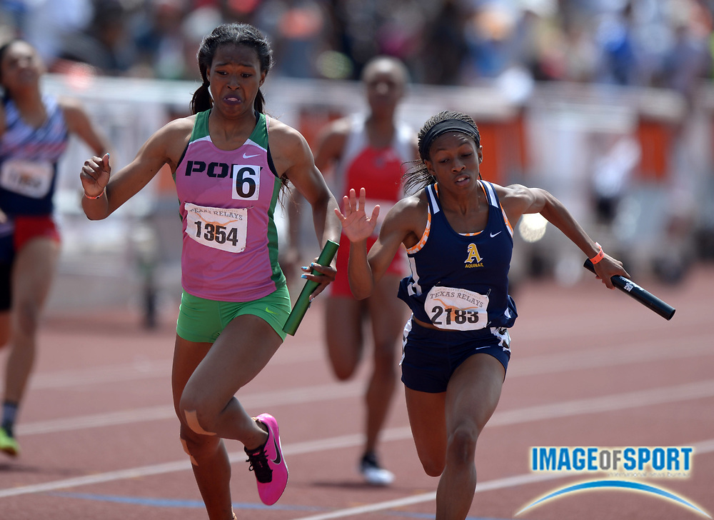 Mar 29, 2014; Austin, TX, USA; Ariana Washington of Long Beach Poly (left) outleans Krystal Sparling of St. Thomas Aquinas on the anchor of the Division II girls 4 x 100m relay, 45.73 to 45.75, in the 87th Clyde Littlefield Texas Relays at Mike A. Myers Stadium.