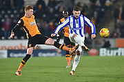 Hull City midfielder Sam Clucas (11),Gary Hooper of Sheffield Wednesday during the Sky Bet Championship match between Hull City and Sheffield Wednesday at the KC Stadium, Kingston upon Hull, England on 26 February 2016. Photo by Ian Lyall.