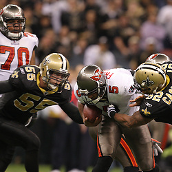 Dec 27, 2009; New Orleans, LA, USA;  New Orleans Saints linebacker Scott Fujita (55)and linebacker Jonathan Casillas (52) pressure Tampa Bay Buccaneers quarterback Josh Freeman (5) during the second quarter at the Louisiana Superdome. Mandatory Credit: Derick E. Hingle-US PRESSWIRE..