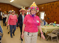 "Carole Veer sports a ""hot pink chick"" during the Easter Bonnet parade with the Laconia Elders Friendship Club at Leavitt Park Clubhouse Wednesday afternoon.  (Karen Bobotas/for the Laconia Daily Sun)"