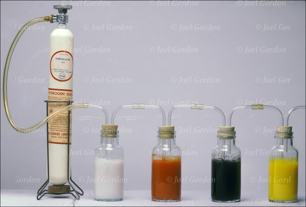 (1) Metal sulfides - from left to right, four solutions contain nitrates of zinc, antimony(III), lead and cadmium.(2) Metal sulfides - left to right, hydrogen sulfide gas bubbling though the solutions produces changes: nitrates of zinc (white), antimony(III) (red), lead (black) and cadmium (yellow)