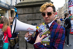 Actor promoting his theatre show on  High Street during Edinburgh Fringe Festival 2016 in Scotland , United Kingdom