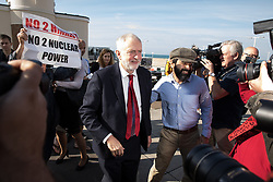© Licensed to London News Pictures . 24/09/2017. Brighton, UK. JEREMY CORBYN leaves the Marr Show surrounded by media and Stuart Holmes protesting . The first day of the Labour Party Conference in and around The Brighton Centre . Photo credit: Joel Goodman/LNP