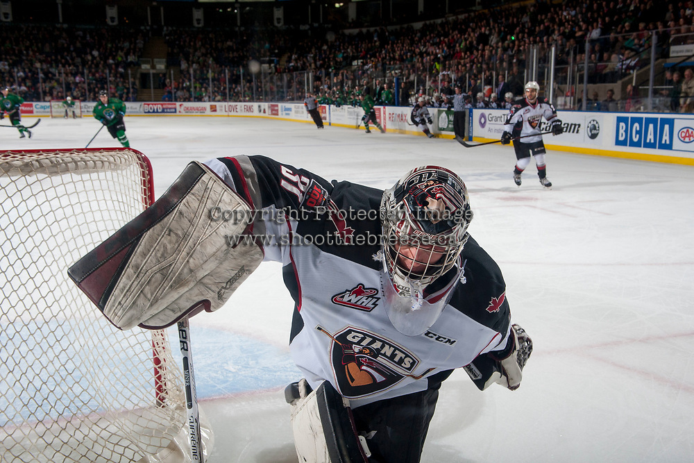 KELOWNA, CANADA - MARCH 18:  Trent Miner #31 of the Vancouver Giants stops the puck behind the net during first period against the Kelowna Rockets on March 1, 2018 at Prospera Place in Kelowna, British Columbia, Canada.  (Photo by Marissa Baecker/Shoot the Breeze)  *** Local Caption ***