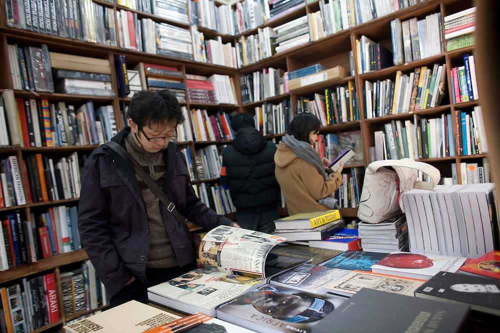 Customers peruse art books at Timezone 8 bookstore in the 798 art district.