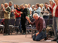 Ken Crutchley of Marion kneels as he prays during The Response Iowa at River of Life Ministries, 3801 Blairs Ferry Rd NE, in Cedar Rapids on Tuesday evening, December 6, 2011. The Response gathered people from all ages, denominations and backgrounds in prayer and fasting on behalf of the nation. (Stephen Mally/Freelance)