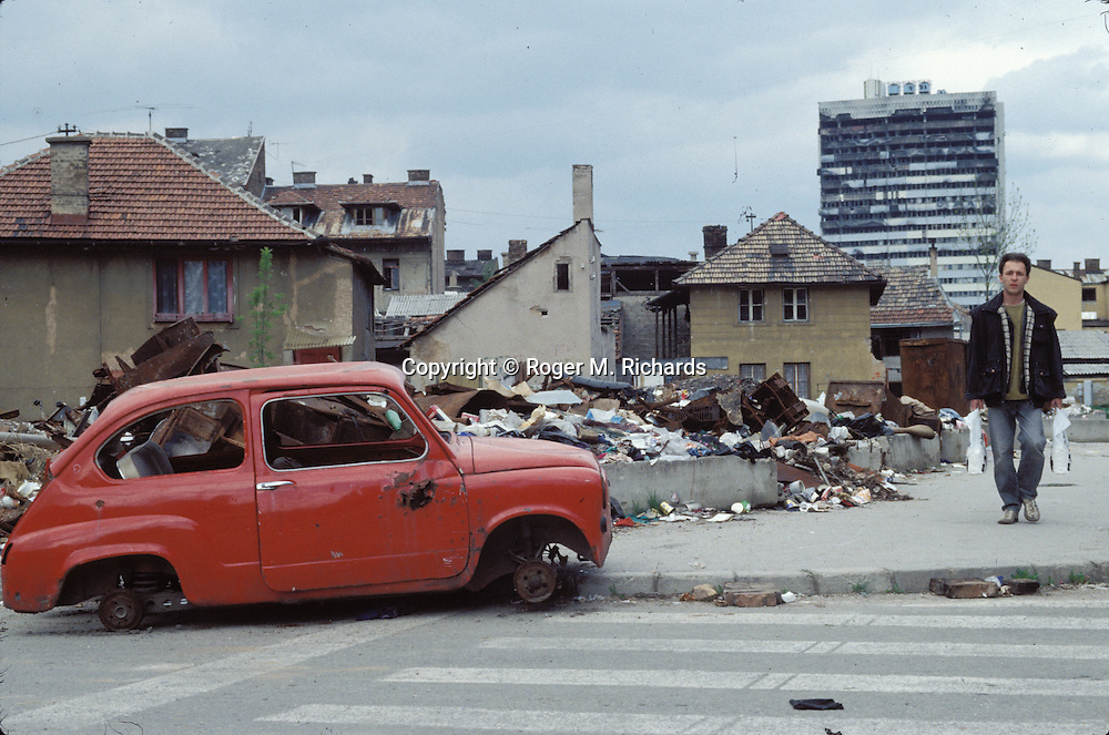 A man walks in the debris of the neighborhood of Marindvor, Sarajevo, Bosnia-Herzegovina, May 1994. PHOTO BY ROGER M. RICHARDS