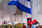 "10 JANUARY 2007 - MANAGUA, NICARAGUA:  ROSARIO MURILLO, left, wide of Nicaraguan President DANIEL ORTEGA, right, take the podium so Ortega can make his inaugural speech in Managua. Ortega, the leader of the Sandanista Front, was sworn in as the President of Nicaragua Wednesday. Ortega and the Sandanistas ruled Nicaragua from their victory of ""Tacho"" Somoza in 1979 until their defeat by Violetta Chamorro in the 1990 election.  Photo by Jack Kurtz"