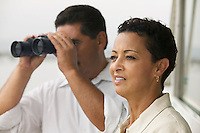 Couple on Boat with Binoculars