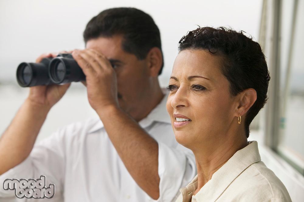 Couple on Boat with Binoculars