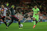 Manchester City forward Sergio Aguero goes around Sunderland goalkeeper Vito Mannone during the Capital One Cup match between Sunderland and Manchester City at the Stadium Of Light, Sunderland, England on 22 September 2015. Photo by Simon Davies.