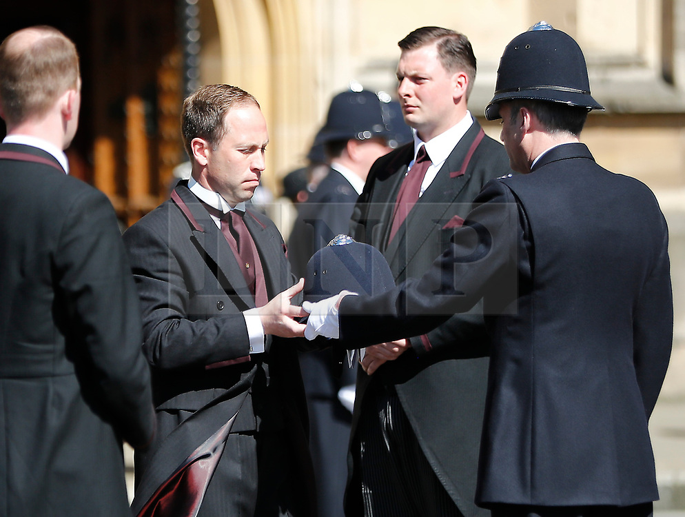 © Licensed to London News Pictures. 09/04/2017. London, UK.  A police helmet belonging to PC Keith Palmer is handed over as thecoffin of arrives at Chapel of St Mary Undercroft within the Palace of Westminster, ahead of his funeral tomorrow (Mon). PC Palmer was killed in a terror attack when Khalid Masood drove a car at pedestrians over Westminster Bridge and then attempted to enter Parliament with a knife. Photo credit: Tolga Akmen/LNP