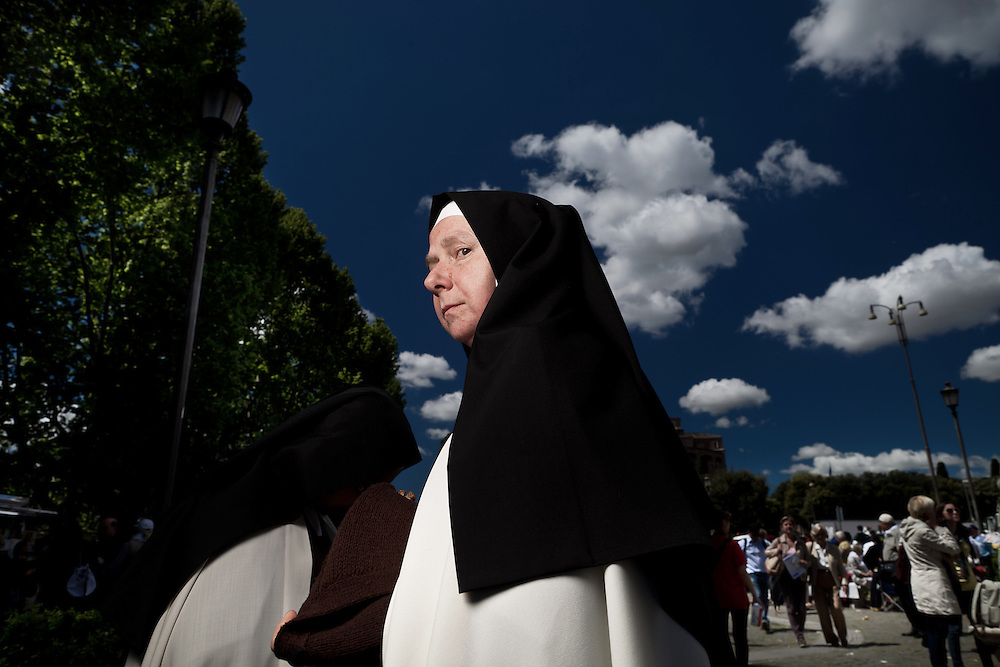 Nuns are seen near St. Peter's Square at end of the ceremony of beatification. On 1 May 2011, six years and one month after his death, Pope John Paul II was beatified by his successor Benedict XVI..It is estimated that over one half million people have taken part in the ceremony which was held in St. Peter's Square, the largest crowd in Rome since his funeral. .This is considered the fastest beatification in Church history, the Vatican will have to attribute another miracle to John Paul's intercession after the beatification, only in this case he will be declared a saint.