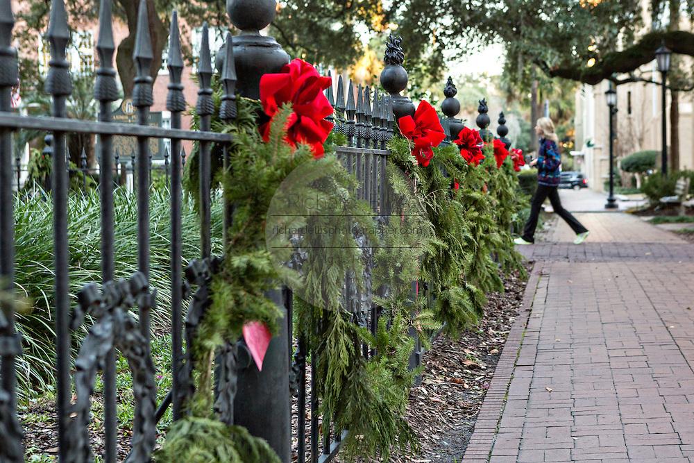 Christmas bows decorate ironwork in Pulaski Square in Savannah, GA.