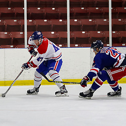 TORONTO, ON - OCT 19:  Matt Steen #47 of the Toronto Jr. Canadiens, skates with the puck, while being pursued by Shawn Tessier #25 of the North York Rangers, during the OJHL regular season game between the Toronto Junior Canadiens  and North York Rangers. on October 19, 2016 in Toronto, Ontario. (Photo by Anna Matthews / OJHL Images)