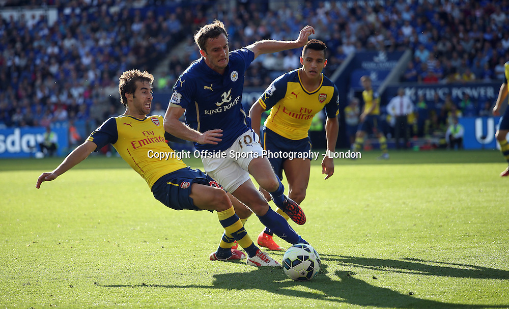 31 August 2014 Premier League Football - Leicester City v Arsenal - Andy King of Leicester is tackled by Mathieu Flamini of Arsenal, watched by Alexis Sanchez.<br /> Photo: Mark Leech