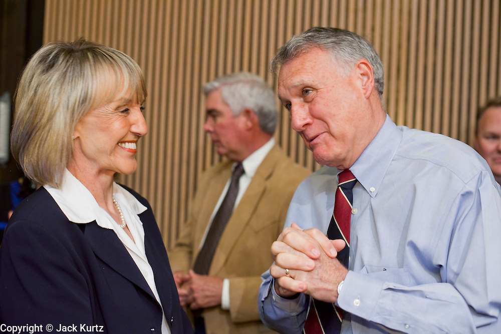 Apr. 20, 2009 -- PHOENIX, AZ: JAN BREWER, Governor of Arizona, talks to US Sen. JON KYL, (R-AZ) before a US Senate committee hearing in Phoenix Monday. The US Senate Committee on Homeland Security and Government Affairs, chaired by Sen. Joe Lieberman (Ind-CT), held a hearing about local perspectives on border violence in the Phoenix City Council chambers in Phoenix, AZ, Monday.   Photo by Jack Kurtz
