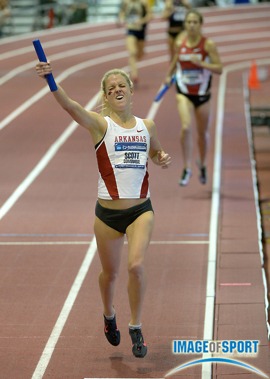 Mar 14, 2014; Albuquerque, NM, USA; Dominique Scott runs the anchor leg on the Arkansas womens distance medley relay that won in 11:05.83 in the 2014 NCAA Indoor Championships at Albuquerque Convention Center.