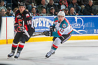 KELOWNA, CANADA - FEBRUARY 18: Erik Gardiner #12 of the Kelowna Rockets stick checks Ryan Schoettler #16 of the Prince George Cougars on February 18, 2017 at Prospera Place in Kelowna, British Columbia, Canada.  (Photo by Marissa Baecker/Shoot the Breeze)  *** Local Caption ***