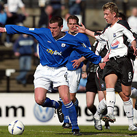 Ayr Utd v St Johnstone...24.04.04  <br />Chris Hay fends off Jamie Doyle<br /><br />Picture by Graeme Hart.<br />Copyright Perthshire Picture Agency<br />Tel: 01738 623350  Mobile: 07990 594431