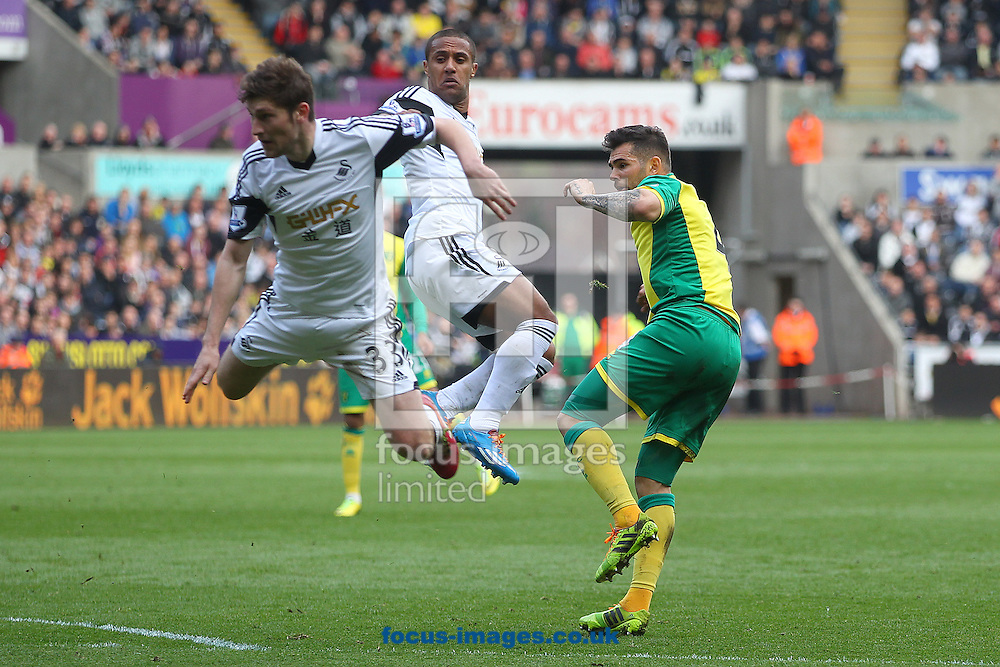 Bradley Johnson of Norwich has a shot on goal during the Barclays Premier League match at the Liberty Stadium, Swansea<br /> Picture by Paul Chesterton/Focus Images Ltd +44 7904 640267<br /> 29/03/2014
