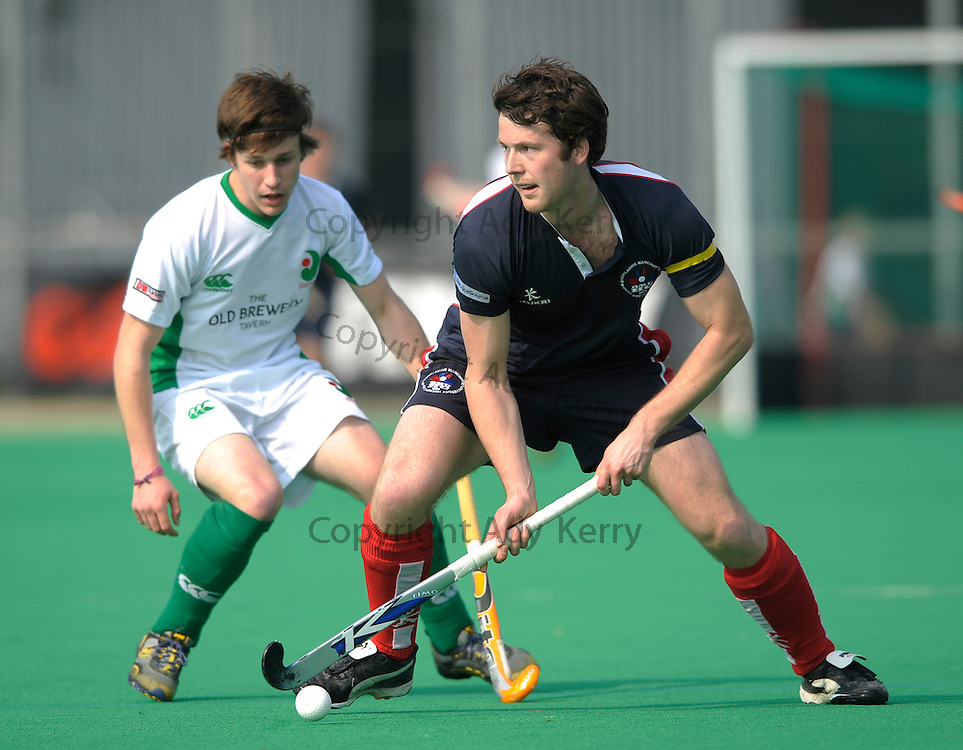 Brookland's Peter Flanagan (R) gets away from Canterbury's Ross Gilham-Jones during their England Hockey League Premier Division match at  Polo Farm, Canterbury, Kent, 27th March 2011.