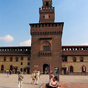 Tourists on the parade ground inside the Sforza Castle, Milan, Italy