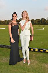 Left to right, PRINCESS TAMARA CZARTORYSKI and NATALIA VODIANOVA at the Chovgan Twilight Polo Gala in association with the PNN Group held at Ham Polo Club, Petersham Close, Richmond, Surrey on 10th September 2014.