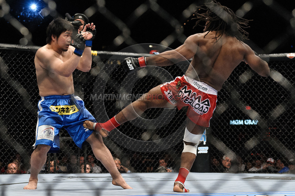 """LAS VEGAS, NEVADA, MAY 24, 2008: Kazuhiro Nakamura (left) retreats from a kick thrown by Thierry Rameau Sokoudjou during """"UFC 84: Ill Will"""" inside the MGM Grand Garden Arena in Las Vegas"""