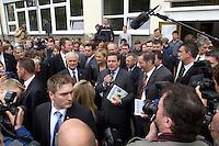 12 MAY 2004, LUDWIGSFELDE/GERMANY:<br /> Gerhard Schroeder (M), SPD, Bundeskanzler, Manfred Stolpe (L), SPD, Bundesverkehrsminister, und Matthias Platzeck (R), Ministerpraesident Brandenburg, umgeben von Journalisten, Personenschuetzern und einigen Schuelern, waehrend dem Besuch der Gesamtschule Ludwigsfelde<br /> Gerhard Schroeder, Federal Chancellor, is visiting a school near Berlin<br /> IMAGE: 20040512-02-010<br /> KEYWORDS: Gerhard Schröder, Schule, Schüler, Fotografen, photographer, pupil, pupils