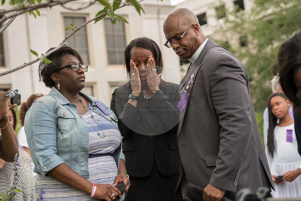 Family members of Rev. Clementa Pinckney, killed in the Mother Emanuel African Methodist Episcopal Church shooting are comforted by Rev. Eric Manning during the unveiling of a memorial marker on the 2nd anniversary of the mass shooting June 17, 2017 in Charleston, South Carolina. Nine members of the historic African-American church were gunned down by a white supremacist during bible study on June 17, 2015.