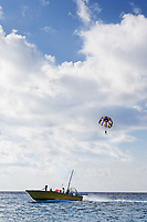 parasailing in the cozumel bay in mexico yucatan