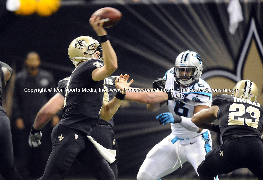 Dec. 8, 2013 - New Orleans, LA, USA - New Orleans Saints' Drew Brees (9) throws a pass against the Carolina Panthers' Greg Hardy (76) tries t pressure in the second quarter at the Mercedes-Benz Superdome in New Orleans on Sunday, Dec. 8, 2013.