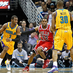 February 12, 2011; New Orleans, LA, USA; New Orleans Hornets point guard Chris Paul (3) drives past Chicago Bulls point guard C.J. Watson (32) during the fourth quarter at the New Orleans Arena.  The Bulls defeated the Hornets 97-88. Mandatory Credit: Derick E. Hingle