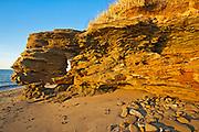 Rocky shoreline along  the Gulf of St. Lawrence at sunrise, Cap Lumiere, New Brunswick, Canada