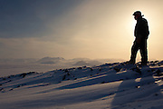 Photographed atop a small mountain (large hill?) overlooking the Arctic Ocean from Ward Hunt Island, the most northerly tip of land in Canada. The silhouette is of a Canadian Ranger, taking a break from patrols as part of Operation Nunalivut.<br /> <br /> Read my full blog post here:  davebrosha.com/2010/05/29/king-of-this-northern-castle/ ( http://davebrosha.com/2010/05/29/king-of-this-northern-castle/ ) <br /> <br /> Join me on Facebook:  www.facebook.com/davebroshaphotography ( http://www.facebook.com/davebroshaphotography ) ?